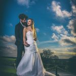 Bride and groom with OCF flash, blue sky Hazlewood Hall
