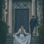 Bride and groom on Stately home steps, Hazlewood Hall